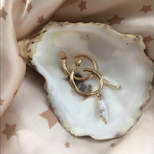 Gold hoop earring with pearl charm